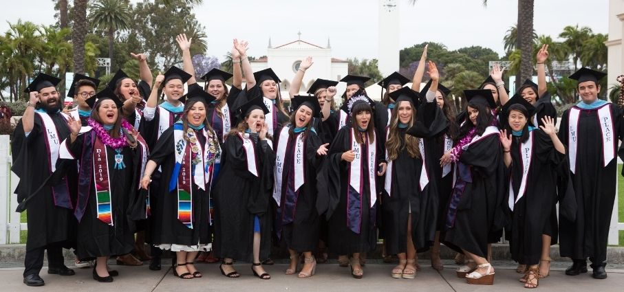 graduates at SO celebrating at commencement on LMU's campus